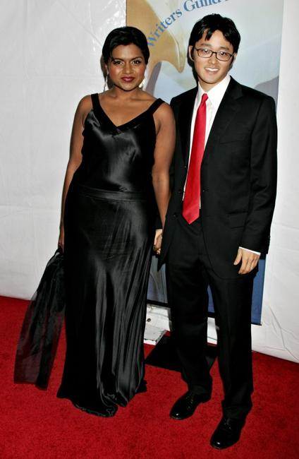 Mindy Kaling and Guest at the 2006 Writers Guild Awards.